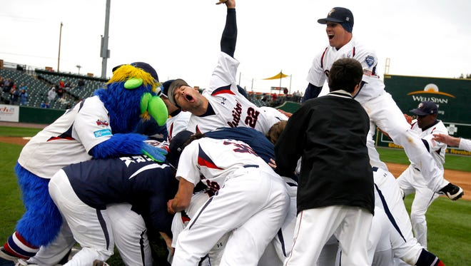 York Revolution mascot Downtown and players celebrate midfield after defeating the Long Island Ducks to win the 2011 Atlantic League Championship.