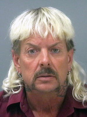 """FILE - This undated file photo provided by the Santa Rose County Jail in Milton, Fla., shows Joseph Maldonado-Passage, also known as Joe Exotic. The former Oklahoma zookeeper sentenced to 22 years in prison for his role in a murder-for-hire plot and violating federal wildlife laws is formally requesting a pardon. Attorneys for  Maldonado-Passage, filed his application Tuesday, Sept. 9, 2020, with the U.S. Department of Justice. In it, Maldonado-Passage maintains his innocence and requests a pardon """"to correct the injustices he has experienced."""""""