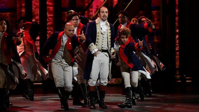 Lin-Manuel Miranda, center, and the cast of 'Hamilton' perform during the 70th Tony Awards.