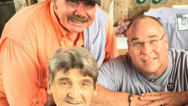 Nick Kolinsky, center, is pictured here with Dave Brandon, left, and Robert St. John.