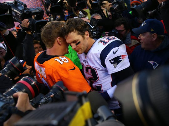 Jan 24, 2016; Denver, CO, USA; Denver Broncos quarterback Peyton Manning (18) greets New England Patriots quarterback Tom Brady (12) following the AFC Championship football game at Sports Authority Field at Mile High. The Broncos defeated the Patriots 20-18 to advance to the Super Bowl. Mandatory Credit: Mark J. Rebilas-USA TODAY Sports