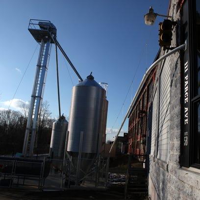 Wheat storage and smoker outside Iron Smoke Whiskey,