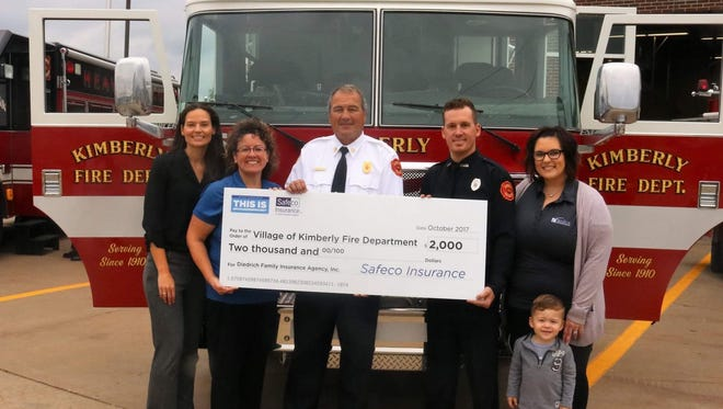 The Village of Kimberly Fire Department was awarded a $2,000 donation from Diedrich Family Insurance Agency. Pictured are, from left, Michelle Rodedl, Safeco Insurance senior territory manager; Wendy Diedrich, Diedrich Family Insurance Agency owner; Bob Van Thiel, Village of Kimberly fire chief; Tyler Huss, Village of Kimberly firefighter; Courtney Huss, Diedrich Family Insurance agent; and Lincoln Huss, son of Courtney and Tyler Huss.