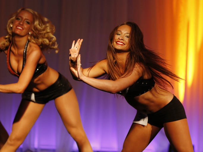 Megan performs during the Cincinnati Ben-Gals cheerleader tryouts at the Newport Syndicate.