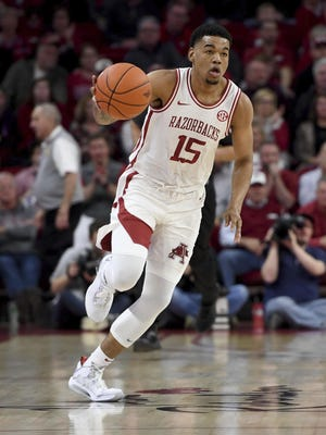 Arkansas guard Mason Jones (15) brings the ball up court against LSU during the first half of an NCAA college basketball game March 4 in Fayetteville.