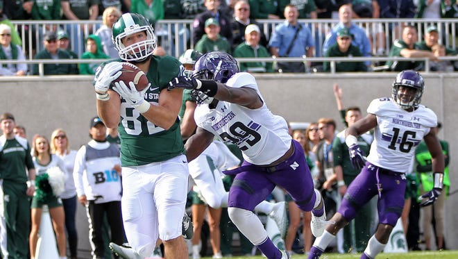Oct 15, 2016; East Lansing, MI, USA; Michigan State Spartans tight end Josiah Price makes a TD catch against the Northwestern Wildcats during the first quarter at Spartan Stadium.