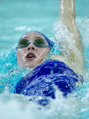 FILE – Carmel's Trude Rothrock won the 100 butterfly, in which she is defending state champ, and took the 200 individual medley.