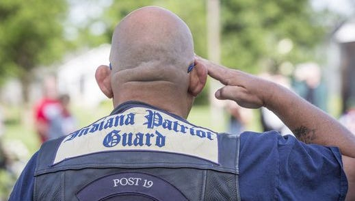 A veteran salutes during a local Memorial Day ceremony.