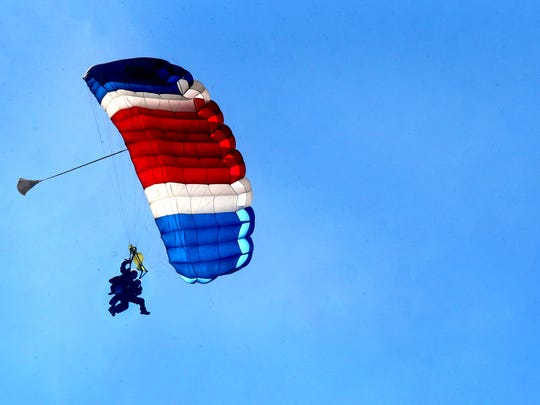 Robert Allman comes in for a landing as he parachutes from an airplane with tandem instructor, Dan Roberts, with Skydive Tennessee, in Tullahoma, on Oct. 21, 2016, 1 day after Allman turned 100.