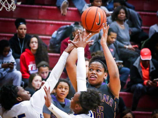 Smyrna's Diamond Forest goes up for a jumper during Thursday's game at the State Farm Classic.