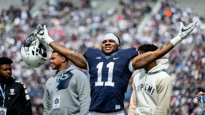Penn State linebacker Micah Parsons acknowledges the crowd before the Blue-White spring college football game Saturday, April 21, 2018, in State College, Pa.