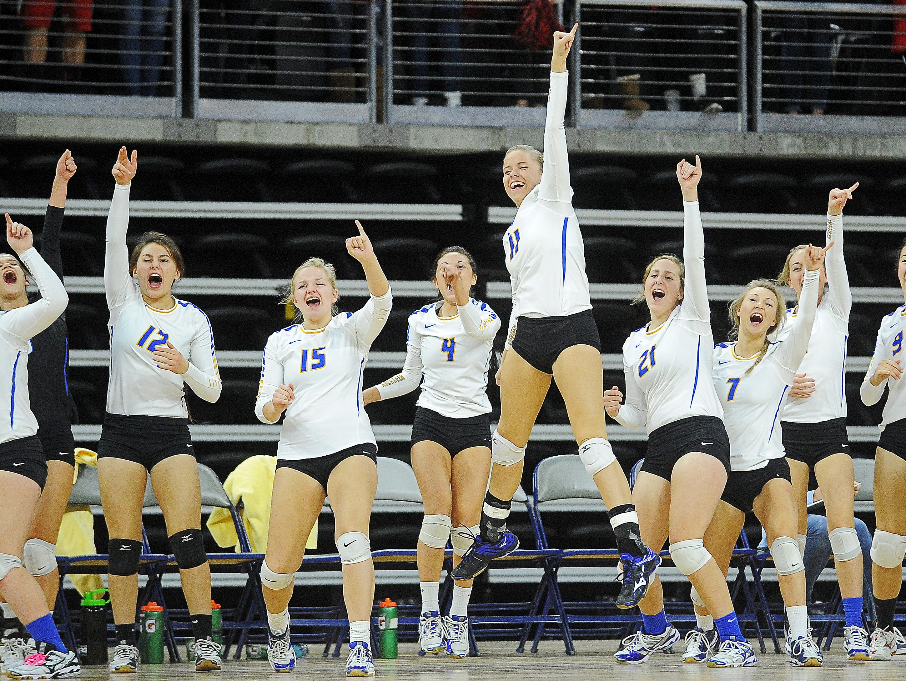 Aberdeen Central players react from the sidelines after their team scored during the South Dakota State High School Class AA championship volleyball match against Brandon Valley Saturday, Nov. 21, 2015, at the Denny Sanford Premier Center in Sioux Falls.