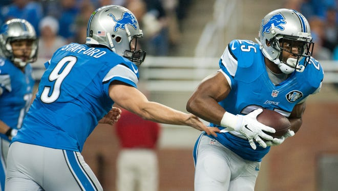 Detroit Lions running back Theo Riddick takes a handoff from Matthew Stafford against the Minnesota Vikings at Ford Field.