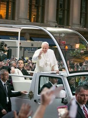 Pope Francis waves to the crowd along 5th Ave upon his arrival in New York City on the way to St. Patrick's Cathedral for evening prayers on Thursday, Sept. 24, 2015.