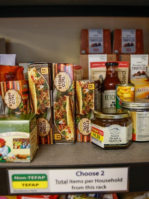 Food sits on shelves ready for taking at the Carmel United Methodist Church Food Pantry on Monday, April 24, 2017.