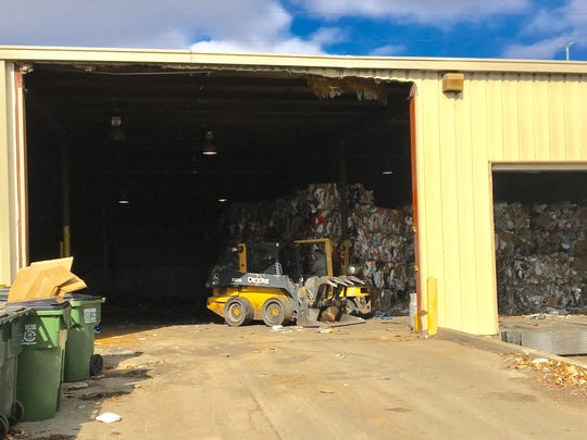 Workers in the warehouse at All in One Recycling in Murfreesboro use forklifts to move some of the intake around the facility.