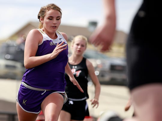 Kirtland Central's Christine Young competes in the 400 meters on Friday at Fred Cook Memorial Stadium in Aztec.