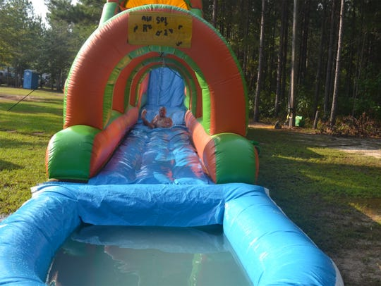 Who says kids get all the fun? There's a huge waterslide