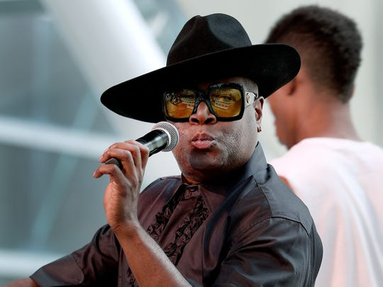The Fabulous Mr. Patrick Bouquett works the microphone as he announces an IBE Summer Celebration fashion show preview at the Indiana Artsgarden Sunday, July 9, 2017