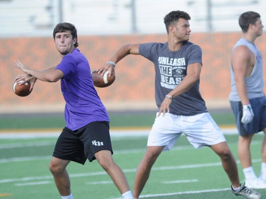Hardin-Simmons freshmen quarterbacks Jeric Smith, left, and Abilene High product Peyton Killam throw during Wednesday's player-run practice.