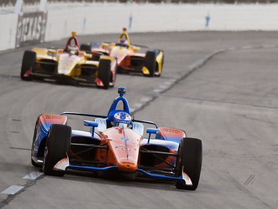 Scott Dixon, of New Zealand, heads into Turn 1 during