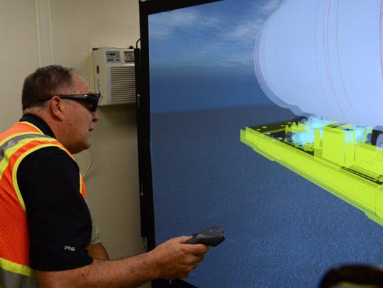 A virtual reality simulator is being used to train