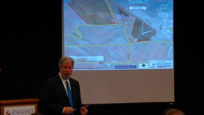 Jon Grafton, executive director of the England Authority, briefs stakeholders Wednesday on efforts to develop industrial sites at England Airpark.