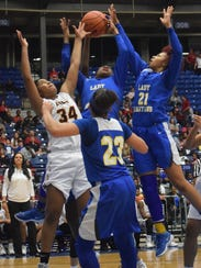 Natchitoches Central senior Trinity Davis (34) goes