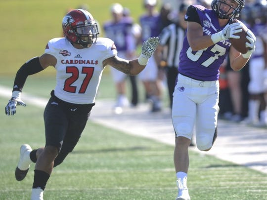 Joey D. Richards/Reporter-News ACU's Josh Fink, right, hauls in a pass from Dallas Sealey as Incarnate Word's Trey Colbert (27) defends. The Wildcats beat Incarnate Word 52-27 in a Southland Conference football game Saturday, Oct. 22, 2016 at Shotwell Stadium.