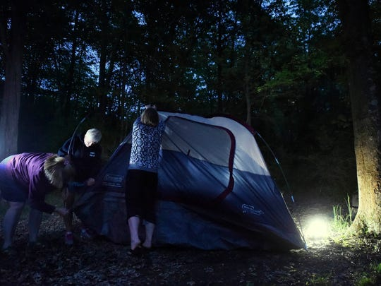 Callie Burnell of Camp Hill, left, and Ava Stoops of New Cumberland, center, help Wendy Huffman of Mount Joy set up her tent at Gifford Pinchot State Park. The three are members of the York Outdoor Adventure meetup.com group on their first camping trip of the summer.