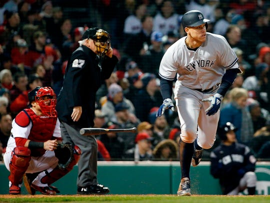 New York Yankees' Aaron Judge heads to first with a