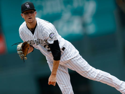 Colorado Rockies starting pitcher Kyle Freeland delivers a pitch to Pittsburgh Pirates' Starling Marte in the first inning of a baseball game Sunday, July 23, 2017, in Denver.(AP Photo/David Zalubowski)