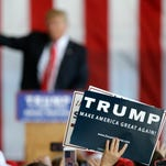 A supporter holds a sign as Republican presidential candidate Donald Trump speaks at a rally on May 6 in Omaha, Neb.