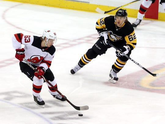 New Jersey Devils left wing Jesper Bratt (63) skates