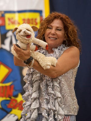 Mallory Lewis, daughter of entertainer Shari Lewis, carries on the legacy started by her mother and performs with Lamb Chop at the Washington County Fair Friday, Aug. 14, 2015.