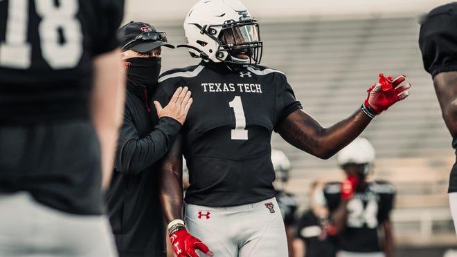 Krishon Merriweather (1) will be at the center of the action this season for the Texas Tech defense. Merriweather is projected to be the Red Raiders' starting middle linebacker after he led the NJCAA with 153 tackles last season for Garden City (Kan.) Community College.