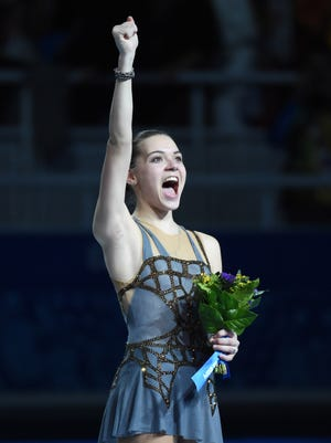 Adelina Sotnikova of Russia celebrates her gold medal in the ladies free skate program during the Sochi 2014 Olympic Winter Games at Iceberg Skating Palace.