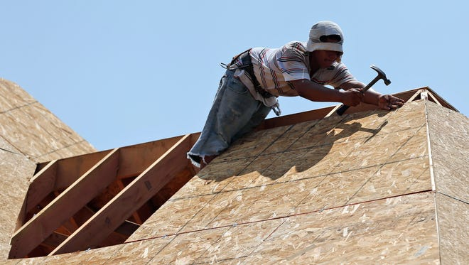 Wages for construction workers have been rising as housing has rebounded. (AP)