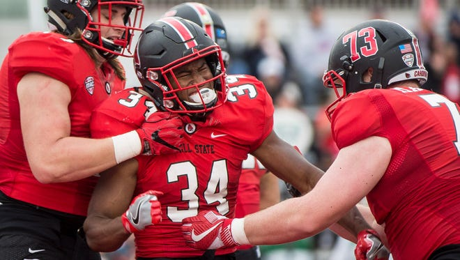 Ball State's James Gilbert celebrates a touchdown with his teammates during the game Saturday afternoon at Scheumann Stadium. Ball State lost to NIU 31-24.