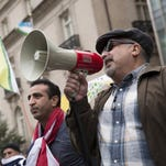Protesters rally against Turkish President Recep Tayyip Erdogan outside of the Brookings Institution in Washington, D.C.