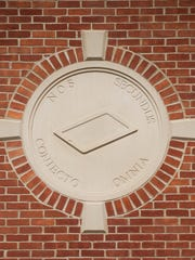 Stone panels embedded in brick walls at the newly built Moorestown Library on Tuesday, October 7, 2014. The panels, engraved with latin phrases are incorrect and will need to be replaced.