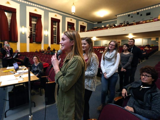 Morgan Heinemann, left, of John Jay High School, talks about the Global Foundries mentoring program during a Wappingers Central School District board meeting at Wappingers Junior High School March 13, 2017.