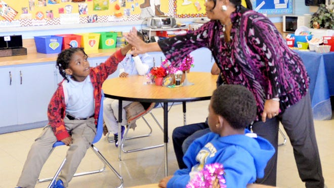 Teacher Rhonda Ansley gives a high five to student Kenneth O'Neal at EB Williams Stoner Hill Elementary Laboratory. EB Williams Stoner Hill Laboratory School is one of three central Shreveport elementary schools proposed to be closed because maintenance costs and population shifts in the cityÕs core.