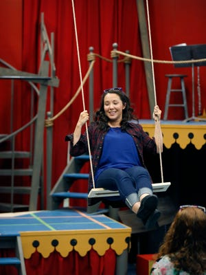 """Lani Toyama Hoskins, in the ensemble as one of the Oswalds, tests a swing during the rehearsal of """"Assassins,"""" the season-opening play at Blackfriars Theatre."""