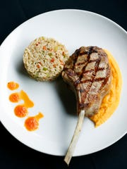 Veal chop with rice pilaf and carrot puree at Tavern