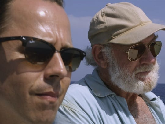Ernest Hemingway (Adrian Sparks, right) and Ed (Giovanni