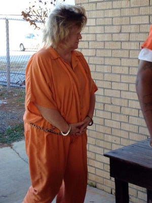 Gina Palasini enters court