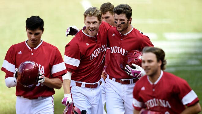 Indiana's Craig Dedelow, Logan Sowers, Brad Hartong and Casey Rodrigue, from left, celebrate after Sowers hits a grand slam against Iowa during the third inning of a third-round Big Ten tournament NCAA college baseball game Friday, May 22, 2015, in Minneapolis. (AP Photo/Hannah Foslien)
