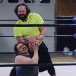 "Former WWE wrestler Nick ""Eugene"" Dinsmore (top) works with Jeremy Gayken in the ring recently at the Midwest All Pro training center in Tea."