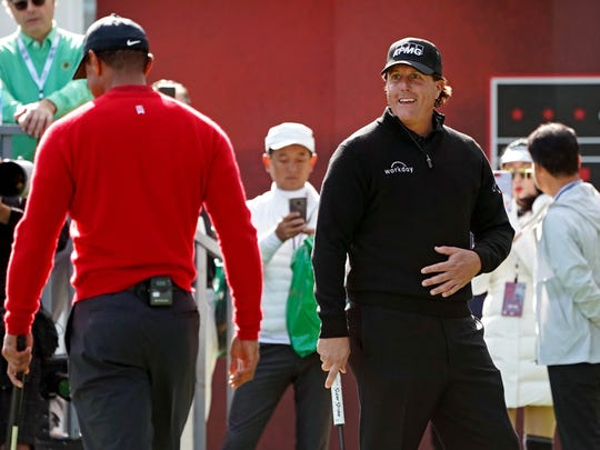 Nov 23, 2018; Las Vegas, NV, USA; Tiger Woods and Phil Mickelson on the putting green before The Match: Tiger vs Phil golf match at Shadow Creek Golf Course. Mandatory Credit: Kyle Terada-USA TODAY Sports